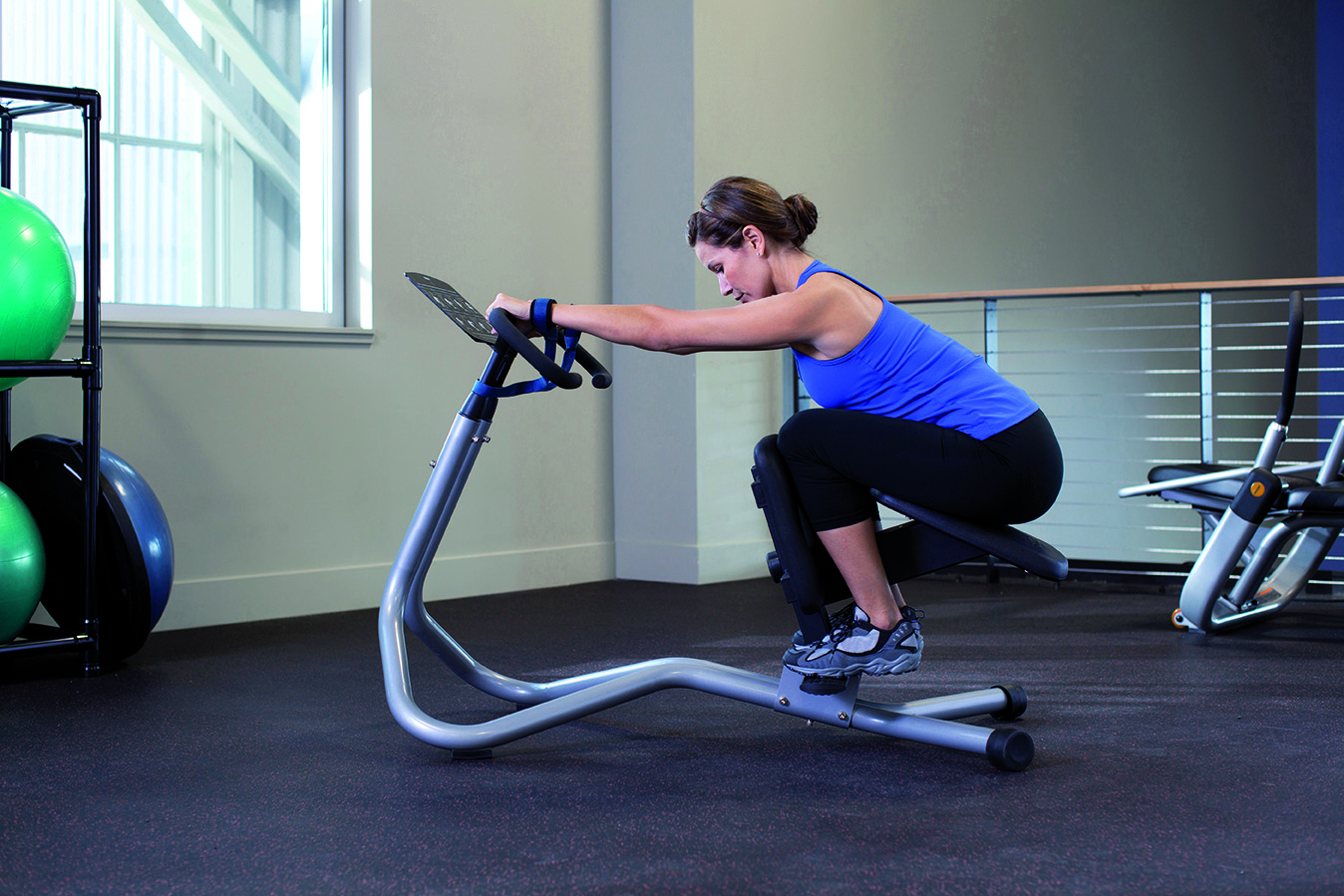 Female in a professional gym using a Precor 240i StretchTrainer