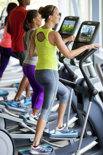 Close up of exercisers on Precor EFX 885 ellipticals with P82 consoles at a fitness center