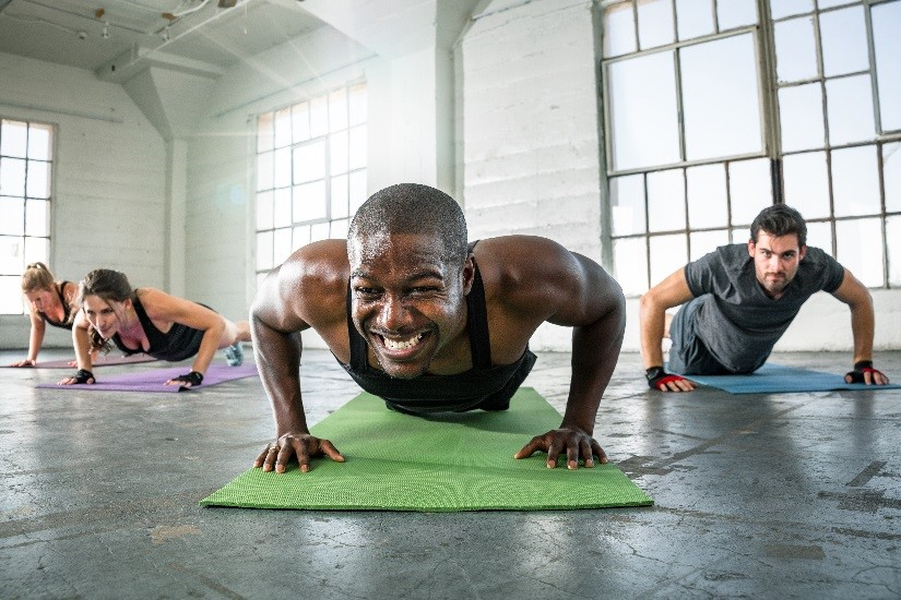 Group of exercisers doing push-ups