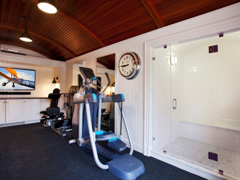 A nantucket garage opens up to an idyllic home gym precor us